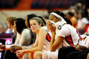 photo - Clemson's Chancie Dunn,right, watches the action from the bench during the first half of an NCAA college basketball game against Maryland Sunday, Jan.27, 2013  at Littlejohn Coliseum in Clemson, S.C.(AP Photo/Richard Shiro)