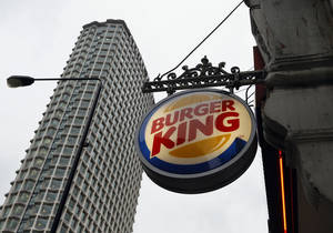 Photo - A sign hangs at a branch of Burger King in central London, Thursday, Jan. 24, 2013. Burger King says it has stopped buying beef from an Irish supplier whose patties in Britain and Ireland were found to contain traces of horsemeat. Officials say there is no risk to human health, but the episode has raised food security concerns. (AP Photo/Kirsty Wigglesworth)