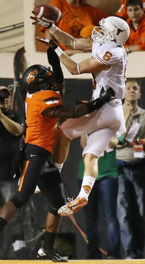 photo - UT&#039;s Jaxon Shipley (8) makes a touchdown catch over OSU&#039;s Kevin Peterson (1) in the third quarter during a college football game between Oklahoma State University (OSU) and the University of Texas (UT) at Boone Pickens Stadium in Stillwater, Okla., Saturday, Sept. 29, 2012. Texas won, 41-36. Photo by Nate Billings, The Oklahoman