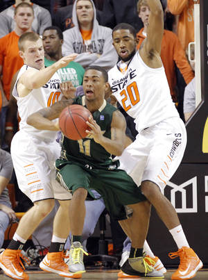 photo - Oklahoma State 's Phil Forte (10) and Michael Cobbins (20) defend on South Florida Bulls' Anthony Collins (11) during the college basketball game between Oklahoma State University (OSU) and the University of South Florida (USF) on Wednesday , Dec. 5, 2012, in Stillwater, Okla.   Photo by Chris Landsberger, The Oklahoman
