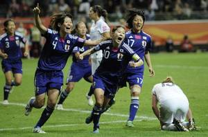 photo - Japan's Homare Sawa, center,  celebrates scoring her side's second goal during the final match between Japan and the United States at the Women's Soccer World Cup in Frankfurt, Germany, Sunday, July 17, 2011. (AP Photo/Martin Meissner) ORG XMIT: WWC235