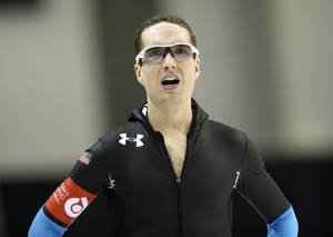 Photo - Jonathan Kuck looks on after competing in the men's 5,000-meter during the U.S. Olympic speedskating trials on Friday, Dec. 27, 2013, in Kearns, Utah. Kuck came in first place. (AP Photo/Rick Bowmer)