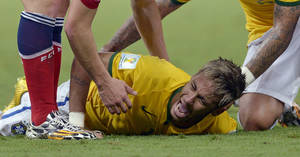 Photo - In this July 4, 2014, photo, Brazil's Neymar screams out after being fouled during the World Cup quarterfinal soccer match between Brazil and Colombia at the Arena Castelao in Fortaleza, Brazil, Friday. The 22-year-old Neymar broke his third vertebra after being kneed in the back by Colombian player Juan Camillo Zuniga in the 86th minute of the match. (AP Photo/Manu Fernandez)