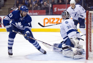 Photo - Toronto Maple Leafs' Nazem Kadri (43) scores his second goal of the game on Tampa Bay Lightning goaltender Ben Bishop during second period of an NHL game in Toronto, Tuesday, Jan. 28, 2014. (AP Photo/The Canadian Press, Frank Gunn)