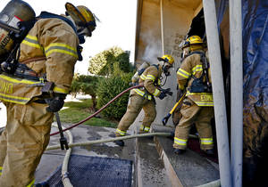 photo - Edmond firefighters prepare to enter a smoke-filled building during a drill. PHOTOs BY CHRIS LANDSBERGER, THE OKLAHOMAN