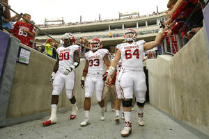 Photo - Oklahoma's team captains David King (90), Trey Millard (33) and Gabe Ikard (64) enter for the coin toss before the college football game between the University of Oklahoma Sooners (OU) and the Texas Christian University Horned Frogs (TCU) at Amon G. Carter Stadium in Fort Worth, Texas, on Saturday, Dec. 1, 2012. Photo by Steve Sisney, The Oklahoman
