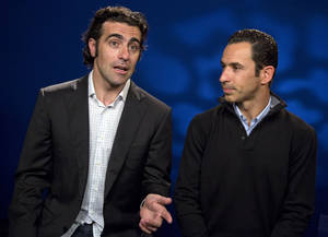Photo - Scotland's Dario Franchitti, left, and Brazil's Helio Castroneves are interviewed, in New York, Monday May 20, 2013. They will try to become the first foreign-born four-time winners in Indianapolis 500 history at Sunday's race. (AP Photo/Richard Drew)