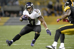 Photo - Baltimore Ravens running back Ray Rice (27) tries to get around Pittsburgh Steelers cornerback William Gay in the fourth quarter of an NFL football game on Sunday, Oct. 20, 2013, in Pittsburgh. (AP Photo/Don Wright)