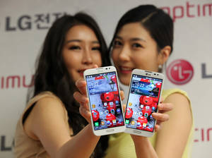 photo - Models pose with LG Electronics' new smartphone Optimus G Pro during a press conference in Seoul, South Korea, Monday, Feb. 18, 2013. LG Electronics Inc. said its Optimus G Pro smartphone with a full high-definition screen will go on sale in South Korea this week and hit shelves in Japan in April.  (AP Photo/Ahn Young-joon)