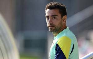 Photo - FC Barcelona's Xavi Hernandez attends a training session at the Sports Center FC Barcelona Joan Gamper in San Joan Despi, Spain, Saturday, Aug. 31, 2013. (AP Photo/Manu Fernandez)