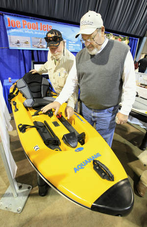 Photo - Garen Draper and Mark Lovelace, both from Oklahoma City, looking at a JetKayak manufactured by Aquanami on display at the RV and Boat show in Oklahoma City Friday, Jan. 10. 2014. Photo by Paul B. Southerland, The Oklahoman