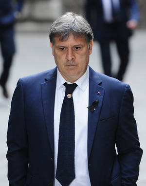"Photo - FC Barcelona's coach Gerardo ""Tata"" Martino arrives for a religious ceremony at Barcelona Cathedral for late former FC Barcelona's coach Tito Vilanova in Barcelona, Spain, Monday, April 28, 2014. FC Barcelona announced on their web page Friday April 25, 2014, that Vilanova had died Friday following a long battle with throat cancer. He was 45. (AP Photo/Manu Fernandez)"