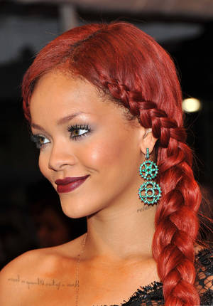 Photo - Rihanna wears a braided style. (Photo by Stephen Lovekin/Getty Images) <strong>Stephen Lovekin</strong>