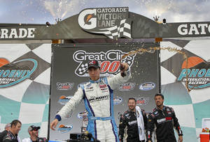 Photo -   Joey Logano celebrates in victory lane after winning the NASCAR Nationwide Series auto race, Saturday, Nov. 10, 2012, at Phoenix International Raceway in Avondale, Ariz. (AP Photo/Matt York)