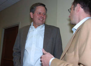 Photo -   Steve Daines, the Republican candidate for Montana's open U.S. House seat, talks with a member of his staff at the Montana Health Care Association annual meeting on Friday, Sept. 21, 2012 in Billings, Mont. (AP Photo/Matthew Brown)