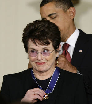 "Photo - FILE - In this Aug. 12, 2009 file photo, President Barack Obama presents the 2009 Presidential Medal of Freedom to Billie Jean King, known for winning the famous ""Battle of the Sexes"" tennis match, and championing gender equality issues,  during ceremonies at the White House in Washington. King believes standing up to discrimination is the best way to combat it. She will help lead the U.S. delegation in the opening ceremonies at the Sochi Olympics in Russia, which recently passed an anti-gay law.  (AP Photo/J. Scott Applewhite, File)"
