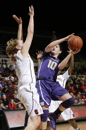 Photo - Washington guard Kelsey Plum (10) shoots next to Stanford forward Mikaela Ruef during the first half of an NCAA college basketball game on Thursday, Feb. 27, 2014, in Stanford, Calif. (AP Photo/Marcio Jose Sanchez)
