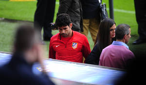 Photo - Atletico Madrid's Diego Costa, leaves the training session at the Camp Nou stadium in Barcelona, Spain, Monday, March 31, 2014. FC Barcelona will face Atletico Madrid in a first leg quarter-final Champions League soccer match April 1. (AP Photo/Manu Fernandez)