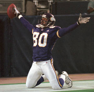 photo - FILE - In this Nov. 8, 1999 file photo, Minnesota Vikings wide receiver Cris Carter (80) celebrates his 6-yard touchdown pass from quarterback Jeff George during the third quarter against the Dallas Cowboys, in Minneapolis. Carter was selected to the Pro Football Hall of Fame on Saturday, Feb. 2, 2013. (AP Photo/Tom Olmscheid, File)