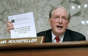 Photo - FILE - In this Sept. 29, 2009, file photo Senate Finance Committee member Sen. Jay Rockefeller, D-W.Va., holds up a report about underpayment to consumers during the markup of health care legislation on Capitol Hill in Washington. U.S. Sen. Jay Rockefeller said Friday, Jan. 11, 2012, that he will not seek a sixth term in 2014, a half-century after he emerged from one of America's most recognizable dynasties to land in West Virginia and climb atop its political ranks. (AP Photo/Susan Walsh, File)