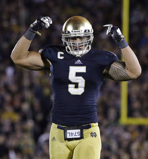 photo -   Notre Dame's Manti Te'o reacts following a tackle during the second half against Michigan during an NCAA college football game on Saturday, Sept. 22, 2012, in South Bend, Ind. Notre Dame defeated Michigan 13-6. (AP Photo/Darron Cummings)
