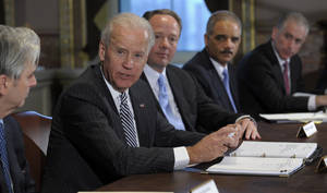 photo - Vice President Joe Biden, second from left, with Attorney General Eric Holder, second from right, speaks during a meeting with representatives from the video game industry in the Eisenhower Executive Office Building on the White House complex in Washington, Friday, Jan. 11, 2013. Biden is holding a series of meetings this week as part of the effort he is leading to develop policy proposals in response to the Newtown, Conn., school shooting. Entertainment Software Association President Mike Gallagher sits between Biden and Holder.  (AP Photo/Susan Walsh)