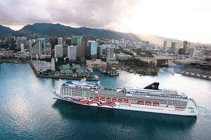 Photo - This undated image provided by Norwegian Cruise Line shows an aerial view of the Norwegian ship Pride of America in Honolulu. The ship sails year-round from Honolulu on Oahu to various ports on the Big Island, Maui and Kauai. A cruise is an easy way to see the Hawaiian islands without having to fly between them. (AP Photo/Norwegian Cruise Line)