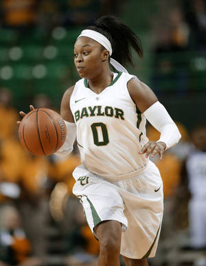 Photo - ADVANCE FOR WEEKEND, FEB. 8-9 - In this Nov. 14, 2013, photo, Baylor guard Odyssey Sims brings the ball up against Nicholls State during an NCAA college basketball game in Waco, Texas. Sims became Baylor's starting point guard as a freshman and almost made it to the NCAA Final Four. She did help the Lady Bears to an undefeated national title as a sophomore, and was part of another deep tourney run last season. (AP Photo/Tony Gutierrez)