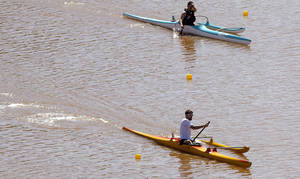 Photo - Jeremy Wagoner and Danzig Norberg compete in the during races for USA Canoe/Kayak Paracanoe World Championship team on the Oklahoma River,  Saturday, April 21, 2012. Photo by Sarah Phipps, The Oklahoman.