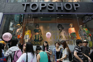 Photo - People line up to enter the first Topshop store in Hong Kong Thursday, June 6, 2013. British fashion chain Topshop opened its first Hong Kong outlet on Thursday, becoming the latest Western brand to brave the city's high rents in a bid to crack the lucrative China market.  (AP Photo/Kin Cheung)
