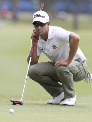 Photo - Adam Scott of Australia lines up a putt on the 10th green during the final round of the Australian PGA golf championship held at the Royal Pines Resort, on the Gold Coast, in Australia, Sunday, Nov. 10, 2013. (AP Photo/Tertius Pickard)