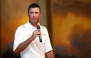 photo - OSU coach Mike Gundy will take his team to Lafayette, La., Friday night. Photo by Sarah Phipps, The Oklahoman