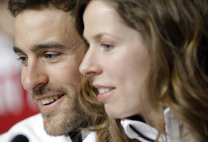 Photo - Denny Morrison, left, a member of the Canadian speed skating team, sits with teammate Christine Nesbitt after a 2014 Winter Olympics team news conference, Tuesday, Feb. 4, 2014, in Sochi, Russia. (AP Photo/Patrick Semansky)