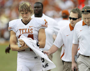 Photo - Texas quarterback David Ash walks off the field after an injury Saturday. Photo by Bryan Terry, The Oklahoman
