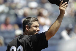 Photo - Chicago White Sox manager Robin Ventura, a former New York Yankees infielder, tips his cap as he is introduced  during Yankees Old Timers Day at Yankee Stadium in New York, Sunday, July 1, 2012.  (AP Photo/Kathy Willens) ORG XMIT: NYY110