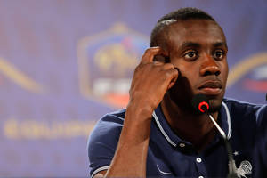 Photo - France's player Blaise Matuidi gestures as he answers questions during a press conference in Ribeirao Preto, Brazil, Friday, June 13, 2014. France is in group E at the World Cup soccer tournament and plays its first match Sunday. (AP Photo/David Vincent)
