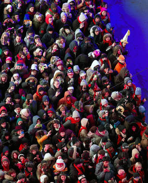 Photo - Looking from the Marriott Marquis hotel, people crowd into Times Square for New Year's Eve celebrations in New York Thursday, Dec. 31, 2013. (AP Photo/Craig Ruttle)