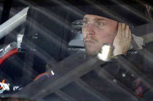 Photo - Denny Hamlin looks out from his car before practice for Sunday's NASCAR Daytona 500 Sprint Cup Series auto race at Daytona International Speedway in Daytona Beach, Fla., Wednesday, Feb. 19, 2014. (AP Photo/John Raoux)