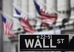 Photo - FILE - This file photo made April 22, 2010 shows a Wall Street sign in front of the New York Stock Exchange. U.S. stock futures rose on Wednesday, May 21, 2014, as investors await the minutes from the Federal Reserve's most recent meeting in April. (AP Photo/Mark Lennihan, File)