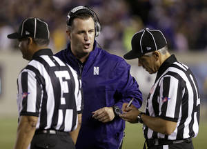 Photo - Northwestern coach Pat Fitzgerald speaks with referees during the first half of an NCAA college football game against California on Saturday, Aug. 31, 2013, in Berkeley, Calif. (AP Photo/Ben Margot)