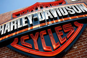 Photo - FILE - This Monday, July 16, 2012, photo, shows a sign for Harley-Davidson Motorcycles at the Harley-Davidsonstore  in Glendale, Calif. Harley-Davidson Inc. reports quarterly earnings on Thursday, Jan. 30, 2014. (AP Photo/Grant Hindsley, File)