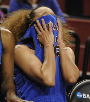 Photo - DePaul's Brittany Hrynko (12) covers her face during the second half of a regional semifinal against Texas A&M in the NCAA women's college basketball tournament Saturday, March 29. 2014, in Lincoln, Neb. (AP Photo/Dave Weaver)