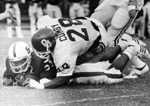 "Photo - Oklahoma linebacker George Cumby smothers Stanford's super halfback Darrin Nelson after a short gain. OU limited Nelson to 29 yards on 10 carries in Saturday's 35-29 Sooner victory at Palo Alto, CA."" Staff photo by Jim Argo taken 9/9/78 <strong>Jim Argo</strong>"