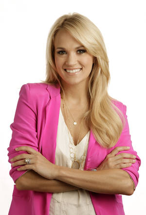 "Photo -   This April 19, 2012 photo shows Carrie Underwood in Nashville, Tenn. Underwood's latest release ""Blown Away,"" was released Tuesday, May 1. (AP Photo/Mark Humphrey)"