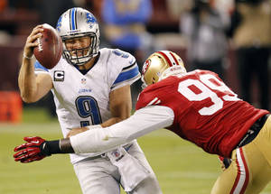 Photo -   Detroit Lions quarterback Matthew Stafford (9) is sacked by San Francisco 49ers outside linebacker Aldon Smith (99) during the fourth quarter of an NFL football game in San Francisco, Sunday, Sept. 16, 2012. San Francisco won 27-19. (AP Photo/Tony Avelar)