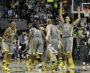 Photo - Baylor players celebrate after the second half in the NCAA Women's Final Four college basketball championship game against Notre Dame, in Denver, Tuesday, April 3, 2012.  Baylor won the championship 80-61.(AP Photo/Julie Jacobson) ORG XMIT: WFF147