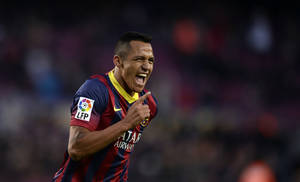 Photo - FC Barcelona's Alexis Sanchez reacts after scoring against Elche during a Spanish La Liga soccer match at the Camp Nou stadium in Barcelona, Spain, Sunday, Jan 5, 2014. (AP Photo/Manu Fernandez)