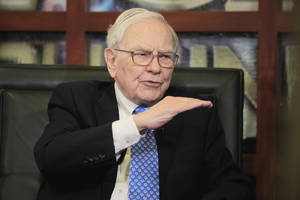 Photo - FILE - In this May 6, 2013 file photo, Warren Buffett, Chairman, President & CEO of Berkshire Hathaway, gestures during an interview with Liz Claman of the Fox Business Network, in Omaha, Neb. Berkshire Hathaway reports quarterly earnings on Friday, May 2, 2014. (AP Photo/Nati Harnik, File)