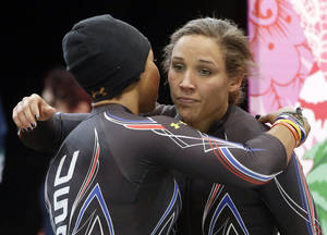 Photo - The team from the United States USA-3, pilot Jazmine Fenlator, left, and brakeman Lolo Jones, hug after their second run during the women's two-man bobsled competition at the 2014 Winter Olympics, Tuesday, Feb. 18, 2014, in Krasnaya Polyana, Russia. (AP Photo/Dita Alangkara)