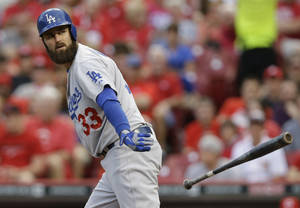 Photo - Los Angeles Dodgers left fielder Scott Van Slyke walks in the fourth inning of a baseball game against the Cincinnati Reds, Monday, June 9, 2014, in Cincinnati. Van Slyke has hit two home runs in the game. (AP Photo/Al Behrman)